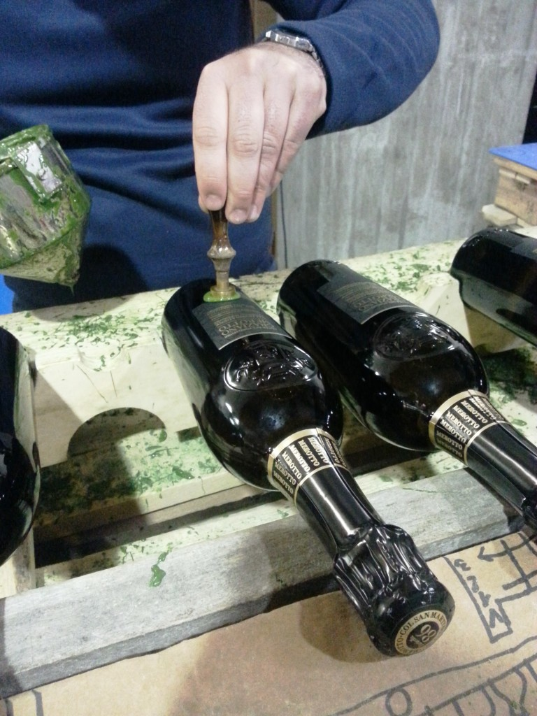 Pressing the seal.. many a hundred bottles all done like this