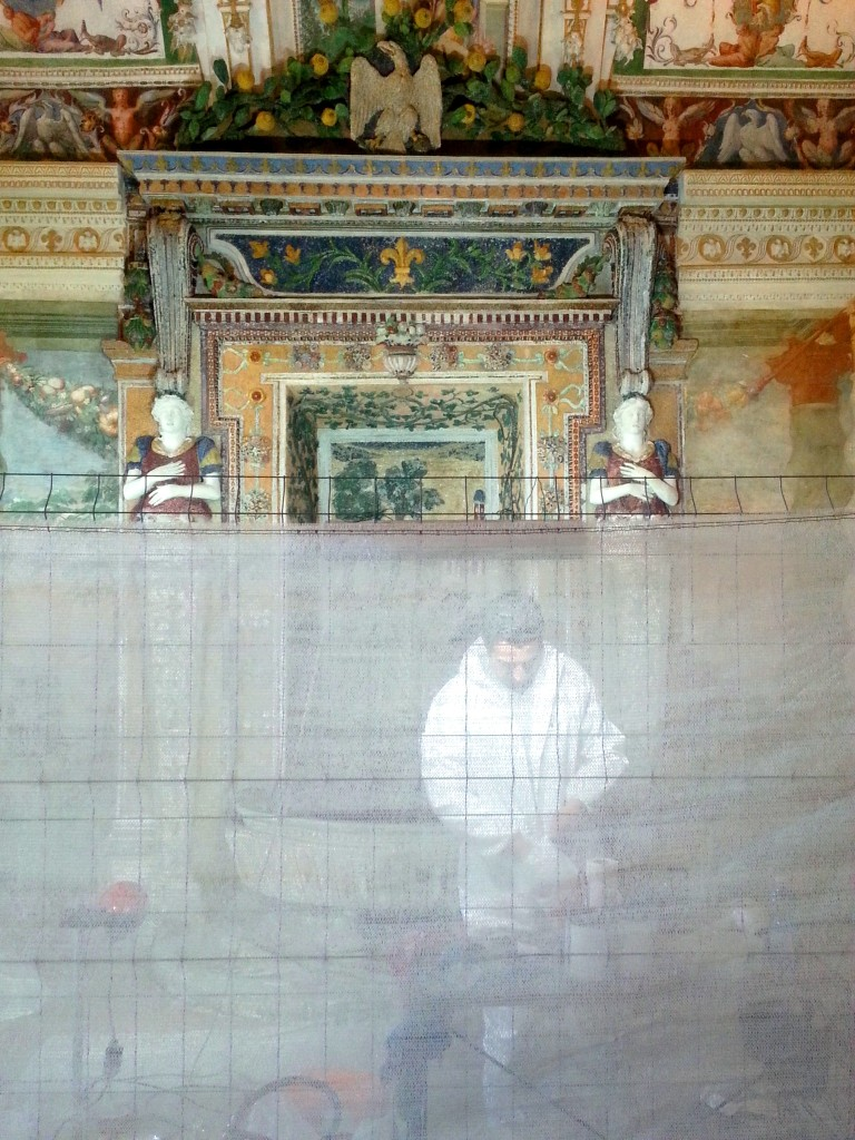 Restoration of a mosaic being performed by a ghost