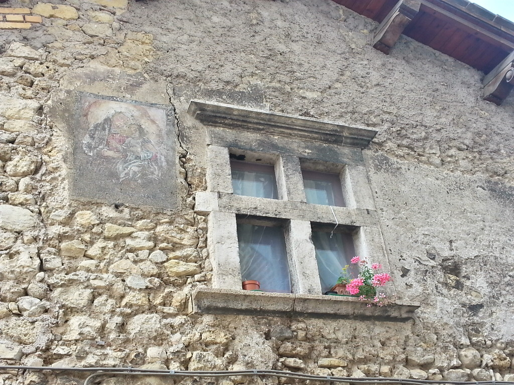 Ancient house with a still preserved fresco