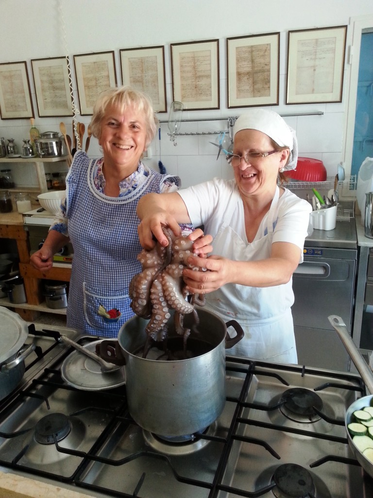Rita and her assistant with 200 year-old recipes in the background